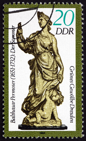 balthasar: Germany - CIRCA 1984: a stamp printed in Germany shows Summer, Figurine by Balthasar Permoser, Green Vault of Dresden, circa 1984 Editorial