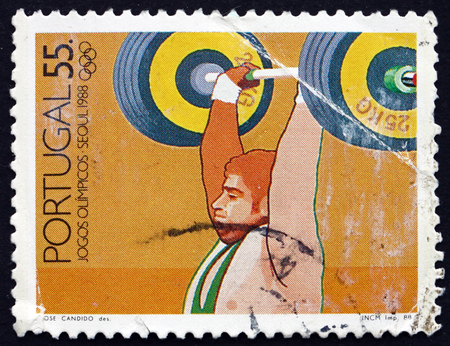 summer olympics: PORTUGAL - CIRCA 1988: a stamp printed in the Portugal shows Weight Lifting, 1988 Summer Olympics, Seoul, circa 1988 Editorial