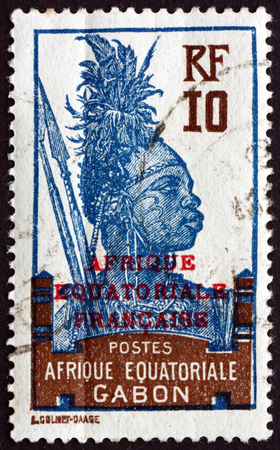 fang: GABON - CIRCA 1926: a stamp printed in the Gabon shows Fang Warrior, circa 1926 Editorial