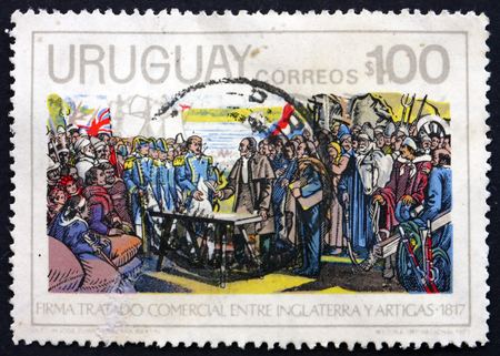 artigas: URUGUAY - CIRCA 1975: a stamp printed in the Uruguay shows General Artigas Signs Trade Agreement with Great Britain, Painting by Jose Zorilla de San Martin, circa 1975