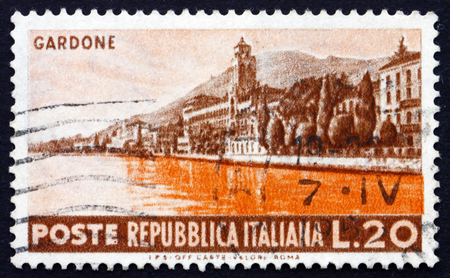 postage stamps: ITALY - CIRCA 1953: a stamp printed in the Italy shows Seaside at Gardone, circa 1953 Editorial