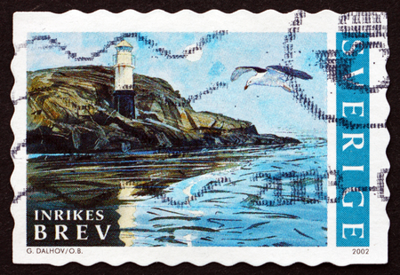 SWEDEN - CIRCA 2002: a stamp printed in the Sweden shows Lighthouse and Gull, Summer in Bohuslan, Sweden, circa 2002