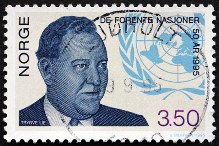 un used: NORWAY - CIRCA 1995: a stamp printed in the Norway shows Trygve Lie, Norwegian Politician and Secretary General, and UN Emblem, circa 1995