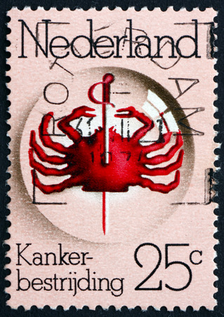 cancer research: NETHERLANDS - CIRCA 1974: a stamp printed in the Netherlands shows Pierced Crab under Lens, 25th Anniversary of Queen Wilhelmina Fund for Cancer Research,  circa 1974