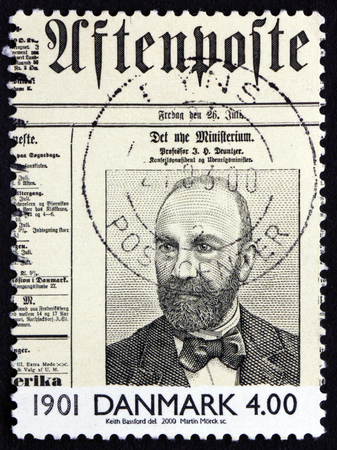 front page: DENMARK - CIRCA 2000: a stamp printed in the Denmark shows Prof. J. H. Deuntzer on Front Page of Newspaper, circa 2000 Editorial