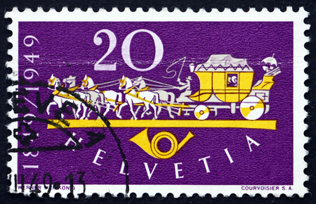 establishment: SWITZERLAND - CIRCA 1949: a stamp printed in the Switzerland shows Horse Drawn Mail Coach, Centenary of the Establishment of the Federal Post in Switzerland, circa 1949 Editorial