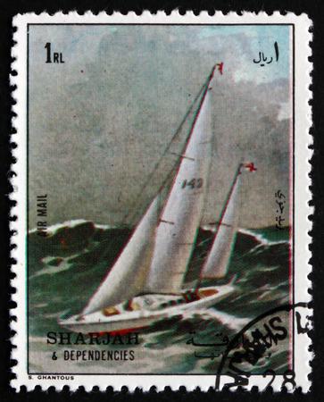 sharjah: SHARJAH - CIRCA 1972: a stamp printed in the Sharjah UAE shows Racing Yacht, Record Atempt, circa 1972 Editorial