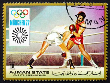 summer olympics: AJMAN - CIRCA 1971: a stamp printed in the Ajman shows Boxing, Summer Olympics 1972, Munich, circa 1971