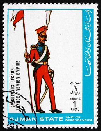 military uniform: AJMAN - CIRCA 1972: a stamp printed in the Ajman shows Military Uniform of Light Cavalry, France, 1st Empire, circa 1972