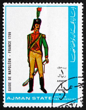 military uniform: AJMAN - CIRCA 1972: a stamp printed in the Ajman shows Military Uniform of Guide de Napoleon, France 1799, circa 1972 Editorial