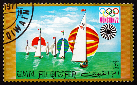 summer olympics: UMM AL-QUWAIN - CIRCA 1971: a stamp printed in the Umm al-Quwain shows Sailing, Summer Olympics 1972, Munich, circa 1971