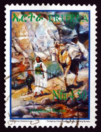 camel post: ERITREA - CIRCA 2004: a stamp printed in the Eritrea shows Highland Woman, Child and Camel, circa 2004