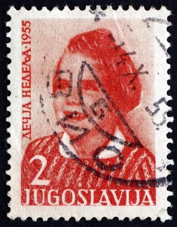 YUGOSLAVIA - CIRCA 1955: a stamp printed in the Yugoslavia shows Girl, circa 1955 Editorial