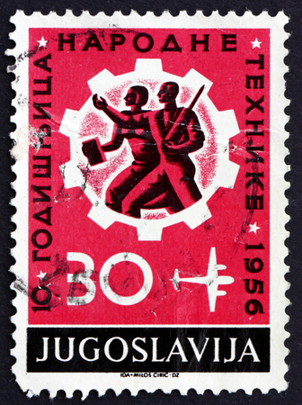 YUGOSLAVIA - CIRCA 1956: a stamp printed in the Yugoslavia shows Workers and Cogwheel, 10th Anniversary of Technical Education, circa 1956 Editorial
