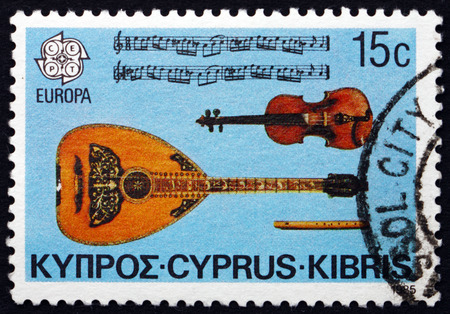 cypriot: CYPRUS - CIRCA 1985: a stamp printed in the Cyprus shows Cypriot Violin, Lute, Flute an the Fourth Womens Dance from the Cyprus Suite, circa 1985 Editorial