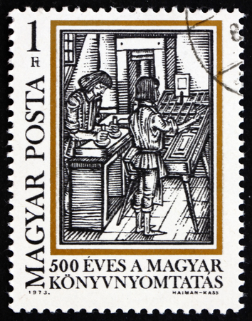 typesetting: HUNGARY - CIRCA 1973: a stamp printed in the Hungary shows Typesetting, from Orbis Pictus, by Comenius, 500th Anniversary of Book Printing in Hungary, circa 1973