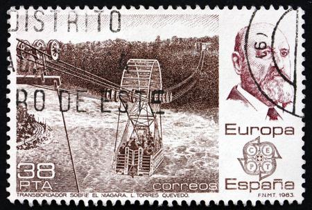 mathematician: SPAIN - CIRCA 1983: a stamp printed in the Spain shows Leonardo Torres Queavedo, Spanish Civil Engineer and Mathematician, and his Niagara Spanish Aerocar, circa 1983