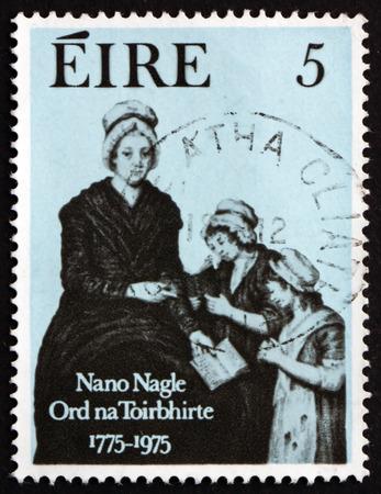 venerable: IRELAND - CIRCA 1975: a stamp printed in the Ireland shows Nano Nagle and Pupils, Engraving by Charles Turner, circa 1975 Editorial
