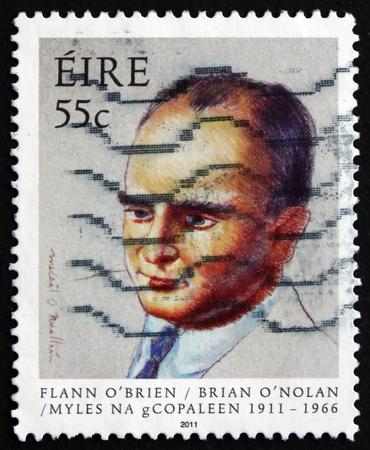 novelist: IRELAND - CIRCA 2011: a stamp printed in the Ireland shows Brian ONolan, Irish Novelist, Playwright and Satirist, circa 2011