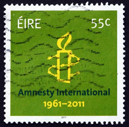 af: IRELAND - CIRCA 2011: a stamp printed in the Ireland shows Amnesty International, 50th Anniversary, circa 2011