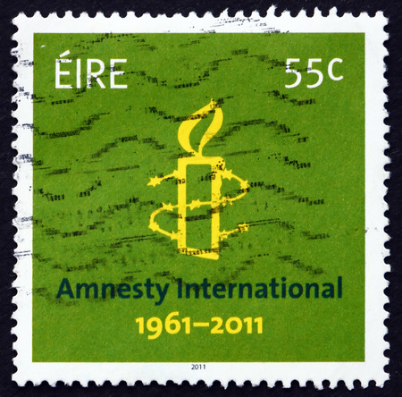 50th: IRELAND - CIRCA 2011: a stamp printed in the Ireland shows Amnesty International, 50th Anniversary, circa 2011