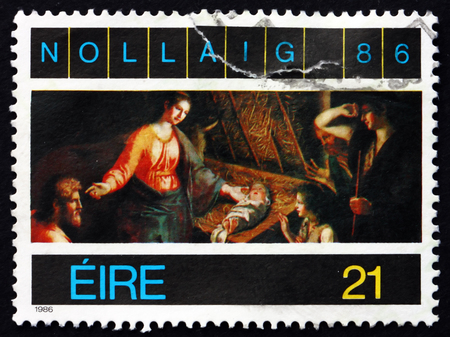 adoration: IRELAND - CIRCA 1987: A stamp printed in Ireland shows Adoration of the Shepherds, Painting by Francesco Pascucci, Christmas, circa 1987