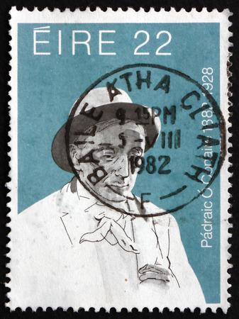 essayist: IRELAND - CIRCA 1982: A stamp printed in Ireland shows Padraic OConnaire, Irish Writer and Journalist, circa 1982 Editorial