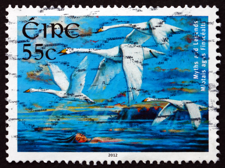 legend: IRELAND - CIRCA 2012: A stamp printed in Ireland shows Children of Lir, is an Irish Legend, circa 2012