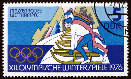the olympic games: GERMANY - CIRCA 1975: a stamp printed in Germany shows Tobogganing, 12th Winter Olympic Games, Innsbruck, Austria, circa 1975