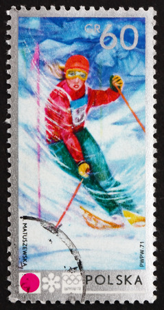 11th: POLAND - CIRCA 1972: a stamp printed in Poland shows Women�s Slalom, and Emblem, 11th Winter Olympic Games, Sapporo, Japan, circa 1972 Editorial