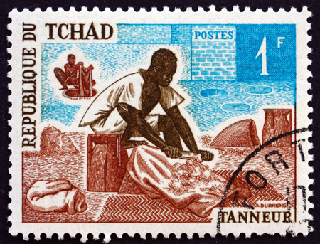 chadian: CHAD - CIRCA 1970: a stamp printed in Chad shows Tanner, occupation, circa 1970 Editorial