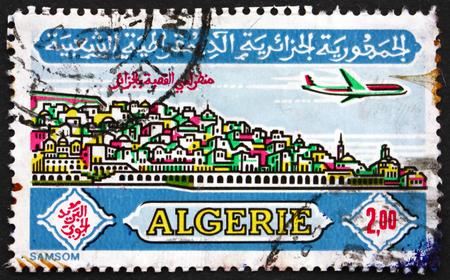algiers: ALGERIA - CIRCA 1971: a stamp printed in Algeria shows Plane over Casbah, Algiers, circa 1971