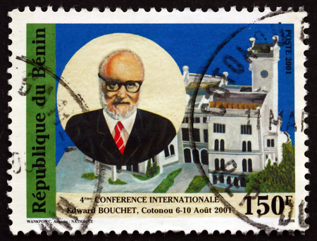 benin: BENIN - CIRCA 2001: a stamp printed in Benin shows Abdus Salam and Building, Cotonou, circa 2001