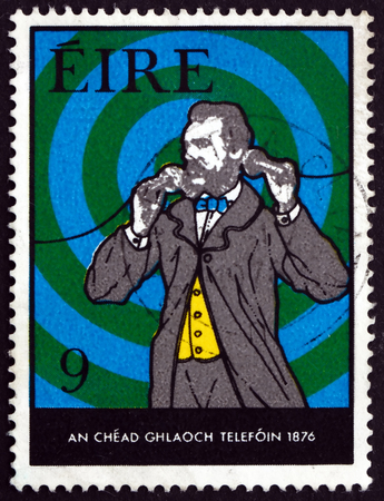 centenary: IRELAND - CIRCA 1976: A stamp printed in Ireland shows Bell Making First Call, Centenary of First Telephone Call by Alexander Graham Bell, circa 1976