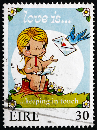 keep in touch: IRELAND - CIRCA 1998: A stamp printed in Ireland shows Love is Keeping in Touch, Greetings Stamp, circa 1998