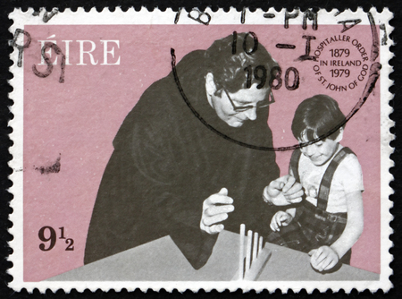 st john: IRELAND - CIRCA 1979: A stamp printed in Ireland shows Hospitaler Brother Teaching Child, Hospitaller Order of St. John of God, Centenary in Ireland, circa 1979