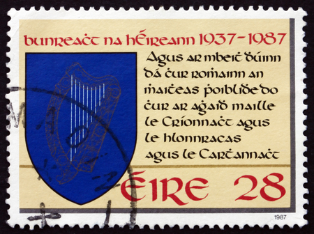 preamble: IRELAND - CIRCA 1987: A stamp printed in Ireland shows Harp in Shield and Preamble Excerpt, 50th Anniversary of the Irish Constitution, circa 1987