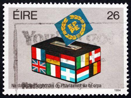 european parliament: IRELAND - CIRCA 1984: A stamp printed in Ireland shows Flags, 2nd European Parliament Election, circa 1984