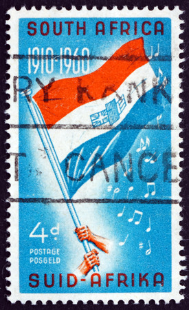 founding: SOUTH AFRICA - CIRCA 1960: a stamp printed in South Africa shows Flag and Notes from National Anthem, 50th Anniversary of the Founding of the Union, circa 1960