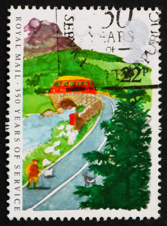 royal mail: GREAT BRITAIN - CIRCA 1985: a stamp printed in Great Britain shows Postbus on Country Road, Royal Mail Service, 350th Anniversary, circa 1985 Editorial