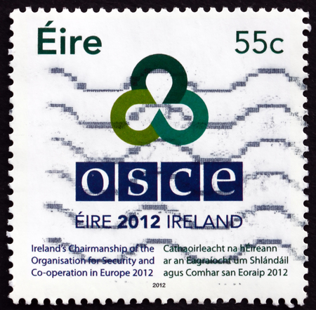 presidency: IRELAND - CIRCA 2012: a stamp printed in Ireland shows Irish Presidency of OSCE, Organization for Security and Co-operation in Europe, circa 2012