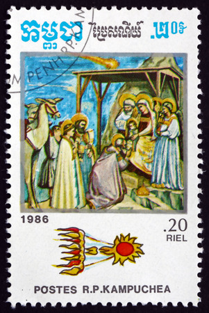 adoration: CAMBODIA - CIRCA 1986: a stamp printed in Cambodia shows Comet above Adoration of the Magi in Painting by Giotto, Halley�s Comet, circa 1986 Editorial
