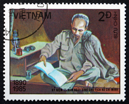 the prime minister: VIETNAM - CIRCA 1985: a stamp printed in Vietnam shows Ho Chi Minh, Reading, was a Vietnamese Communist Revolutionary Leader, Prime Minister and President, circa 1985