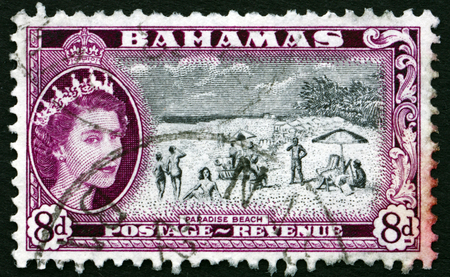 queen elizabeth ii: BAHAMAS - CIRCA 1954: a stamp printed in Bahamas shows Paradise Beach, and Queen Elizabeth II, circa 1954