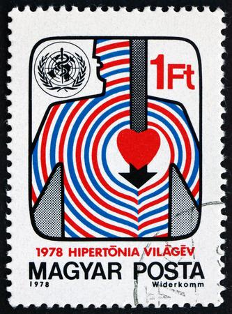 hipertension: Hungría - alrededor de 1978: un sello impreso en Hungría muestra estilizada del cuerpo y del corazón, Unidad contra la hipertensión, alrededor de 1978 Editorial