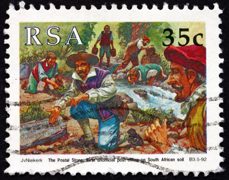 discovering: SOUTH AFRICA - CIRCA 1992: a stamp printed in South Africa dedicated to Postal Stone, Sailors Discovering Postal Stone near Versse River, circa 1992
