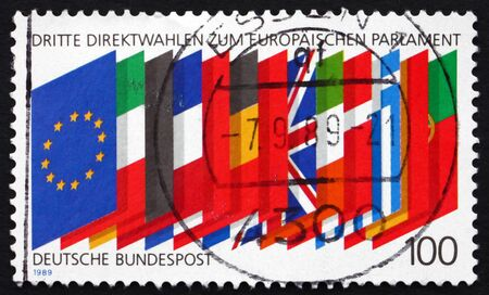 european parliament: GERMANY - CIRCA 1989: a stamp printed in Germany shows Flags of member Nations, European Parliament 3rd Elections, circa 1989