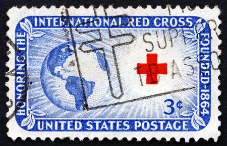 cruz roja: EE.UU. - CIRCA 1952: un sello impreso en los EE.UU. dedicado a la Cruz Roja muestra Globe, el Sol y la Cruz, alrededor de 1952
