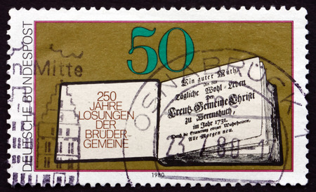 title page: GERMANY - CIRCA 1980: a stamp printed in Germany shows Book of Daily Bible Readings, Title Page, 1731, circa 1980