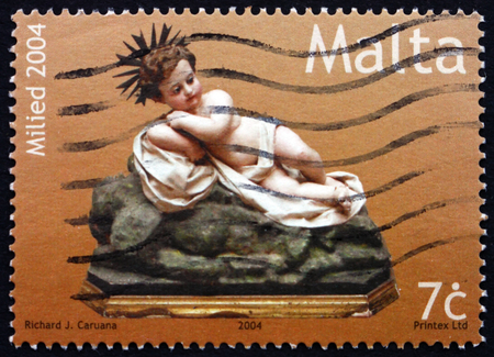 effigy: MALTA - CIRCA 2004: a stamp printed in Malta shows Effigy of Infant Jesus, Christmas, circa 2004 Editorial